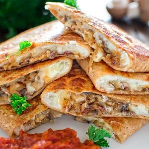 This scrumptious Mashed Potato and Mushroom Quesadilla is filled with caramelized onions, mushrooms, leftover mashed potatoes and gooey cheese. ❤ COOKTORIA.COM